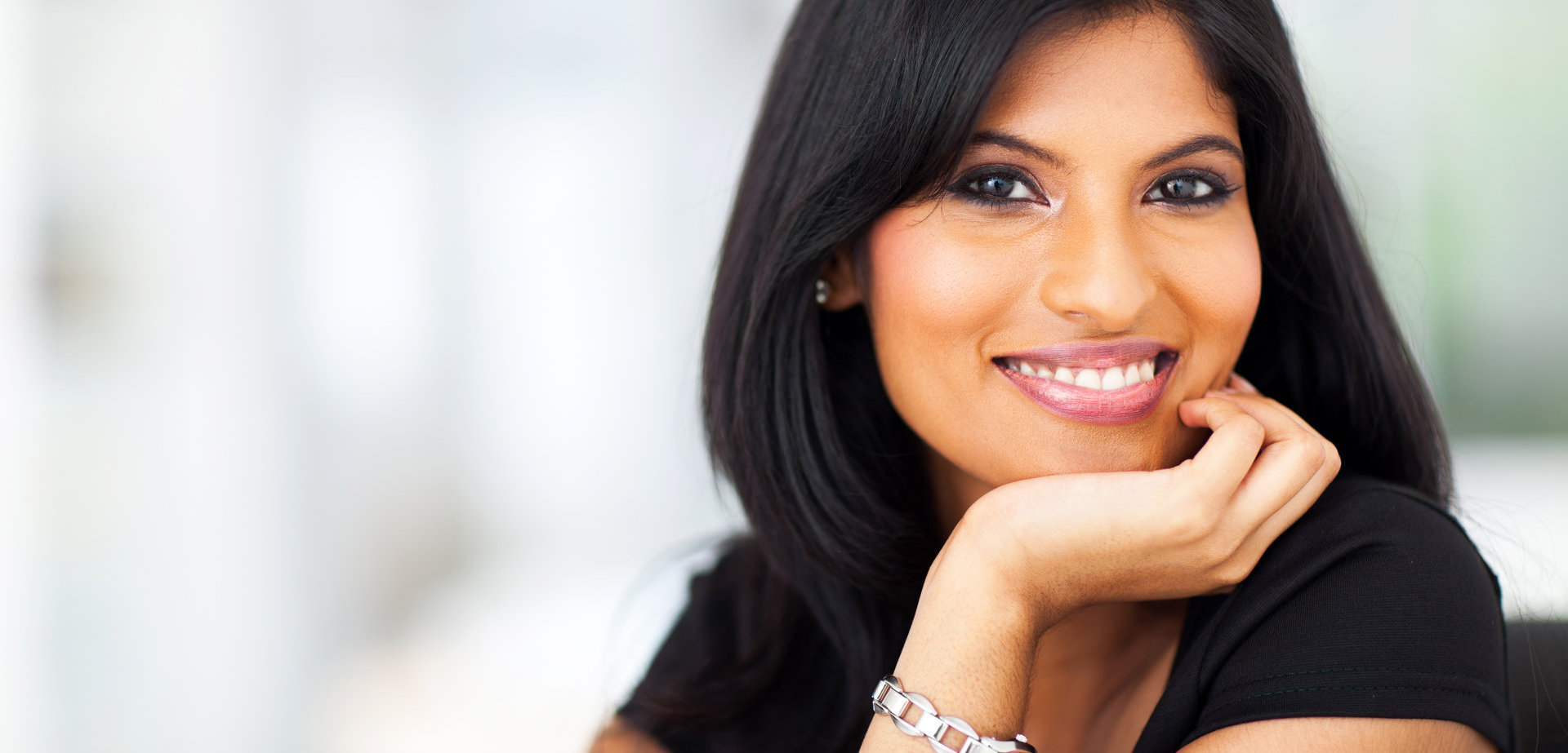 close up portrait of indian smiling businesswoman in office